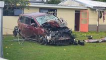 Two injured after car drives off motorway and into a house