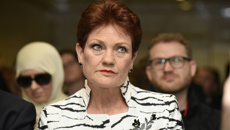Pauline Hanson gets stuck during highly publicised climb of Uluru