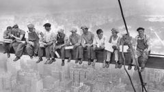 Intrepid steel workers eat lunch atop the 70 story RCA building in Rockefeller Centre in New York in 1932. (Photo / Getty )