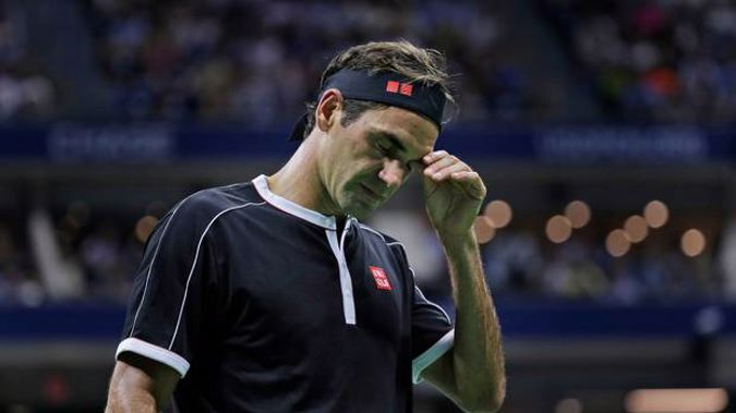 Roger Federer reacts during the match. (Photo / AP)