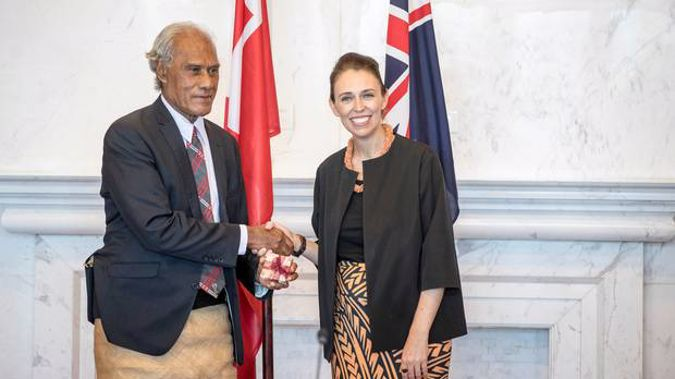 Prime Minister Hon. 'Akilisi Pohiva and The Right Honourable Jacinda Ardern Prime Minister of New Zealand exchange gifts before the start of bilateral talks last year. Photo / AP