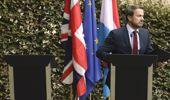 Luxembourg's Prime Minister Xavier Bettel, right, addresses a media conference next to an empty lectern intended for British Prime Minister Boris Johnson. (Photo / AP)