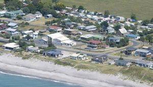 Residents in the Western Bay of Plenty, such as those of Pukehina, are paying the second-highest rates in the country. Photo / File