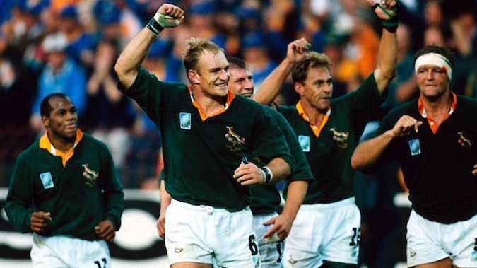 Francois Pienaar and team celeberate after the rugby World Cup final between South Africa and the All Blacks, 24 June 1995. (Photo: PHOTOSPORT)