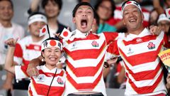 Fans pose for a photo ahead of the Rugby World Cup  game between Japan and Russia. (Photo / Getty Images)