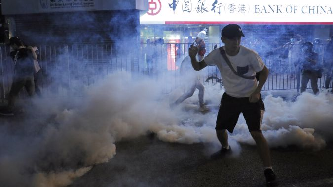 ear fas fills the street as protesters continue to battle with police on the streets of Hong Kong. (Photo / AP)