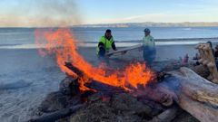 The first fire lit at sunrise to guide the three waka hourua into the bay. (Photo / Twitter, RNZ)