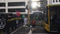 Climate protesters chain themselves to cars and boats in Wellington