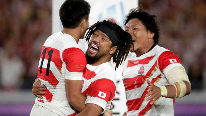 Japan's Kenki Fukuoka celebrates with teammates after scoring against Scotland. Photo / AP