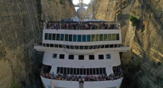 Watch: Cruise ship squeezes through canal in record-breaking voyage