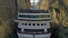 Cruise ship sets record for largest ship to sail the tiny Corinth Canal in Greece