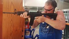 Experts say it appears Jones is holding an AR-15 that is banned in New Zealand. (Photo / Facebook)