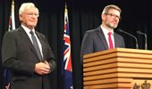 Workplace Relations Minister Iain Lees-Galloway (left) and former National Party prime minister Jim Bolger discussing the Government's plans at an earlier event. (Photo / NZ Herald)