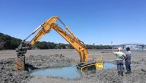 Digger stuck in the mud for three days at Auckland beach