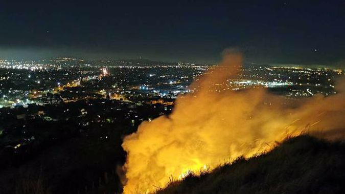A number of fire crews responded to the blaze on Mt Wellington last night. Photo / Will Trafford