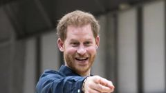 Prince Harry flew commercial back from Japan. (Photo / AP)