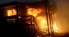 Three confirmed dead as bushfires tear through NSW, Queensland