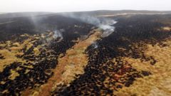 Hotpots could be seen smouldering at the site on Sunday. (Photo / Fire and Emergency NZ)