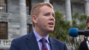 Education Minister Chris Hipkins, speaking to striking teachers and their supporters at Parliament in May, is expected to announced watered-down education reforms today. Photo / Mark Mitchell