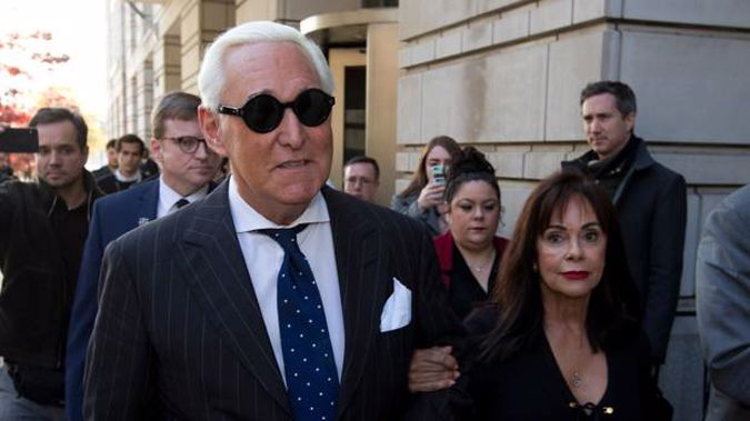Roger Stone, left, with his wife Nydia Stone, leaves federal court in Washington yesterday. (Photo / AP)