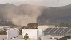 A tornado has injured one person and blown out windows in Christchurch. (Photo / YouTube)