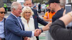 Prince Charles and Camilla take part in a public walk in Auckland. (Photo / Pool)
