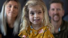 Annabelle, 3, and her parents Maria and Alex Geisler.