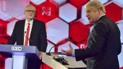 Boris Johnson and Jeremy Corbyn during the last debate. (Photo / AP)