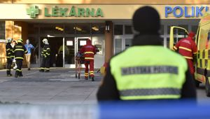 Firefighters, police officers and paramedics in front of the Ostrava Teaching Hospital, after a shooting incident in Ostava, Czech Republic. (Photo / AP)