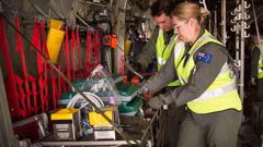 Australian air force personnel prepare equipment on board a C-130J Hercules ahead of a mission to repatriate Australians injured in the White Island eruption. Photo / Supplied