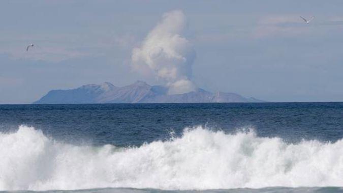Plumes of steam rise above White Island off the coast of Whakatane. Photo / AP
