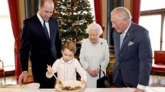 Britain's Queen Elizabeth, Prince Charles, Prince William and Prince George prepare special Christmas puddings. (Photo / AP)