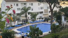 Civil guard diver work at the side of a swimming pool at the Club La Costa World holiday resort near Malaga, Spain. (Photo / AP)