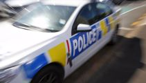 Police car struck with axe, officers injured in dramatic chase