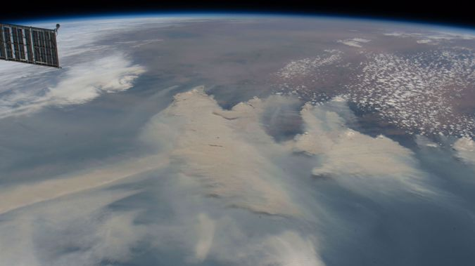 "Smoke from bushfires blankets the southeast coastline of Australia on January 4, 2020, as the International Space Station orbited 269 miles above the above the Tasman Sea. The smoke is expected to make at least one ""full circuit"" around the globe and return to the skies over the country, scientists from NASA have warned."