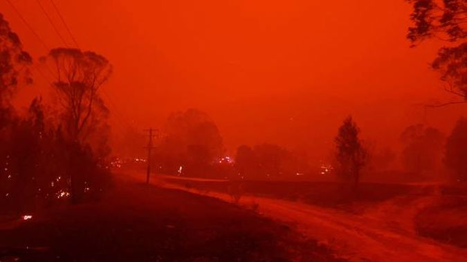Fire and thick smoke in the village of Nerrigundah, Australia. Photo / AP
