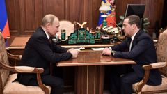 Russian President Vladimir Putin meets with Prime Minister Dmitry Medvedev in Moscow on January 15. (Photo / Getty)