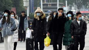 Face masks sold out and temperature checks at airports and train stations became the new norm as China strove to control the outbreak of a new coronavirus. Photo / AP