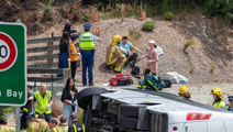 Man charged after pair lose limbs in horror Queenstown bus crash