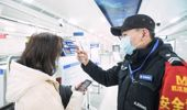 In this photo released by China's Xinhua News Agency, an official checks a passenger's temperature at a subway station in Wuhan in central China's Hubei Province. Photo / AP