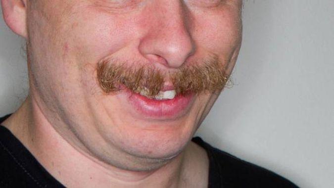 Teacher censured for punching student over 'paedophile moustache' remark