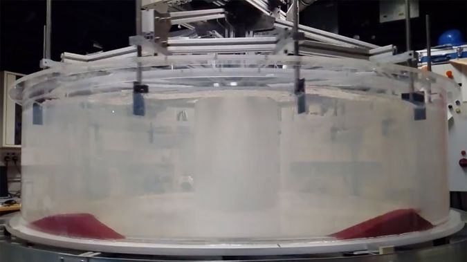 Scientists at Cambridge University tested the movement of sand dunes in a large rotating water tank.