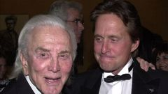 Actor Kirk Douglas and son, actor Michael Douglas, in 2001. Photo / Getty Images