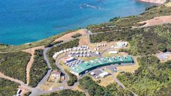 Campervans and caravans are visible at the Defence Force facility at Whangaparāoa, the Tamaki Leadership Centre, where the people evacuated from China will be staying for two weeks in quarantine.