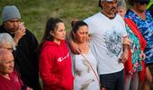 Lynsey Abbott (centre) has organised a karakia at Flaxmere park in support for the toddler beaten in the area. Photo / Paul Taylor