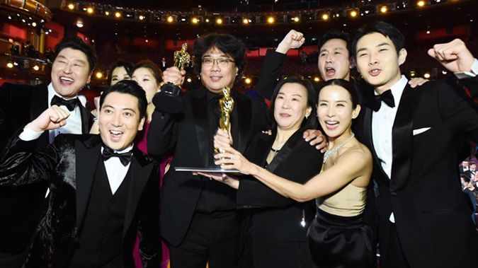 """Cast and crew of """"Parasite"""" at the Oscars after their Best Picture win. (Photo / Getty)"""