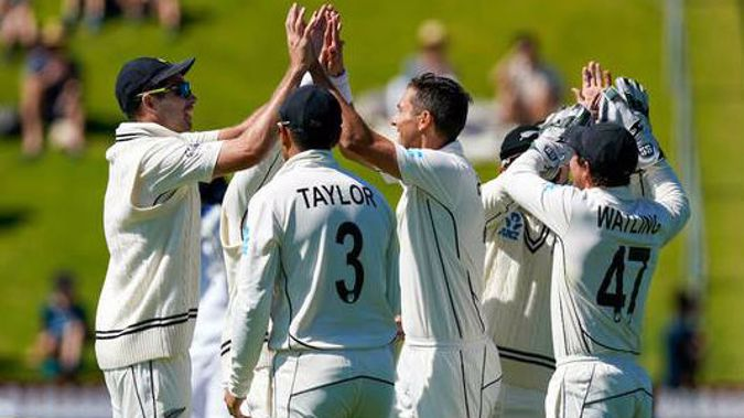 The Black Caps celebrate during their 100th test win. Photo / Photosport