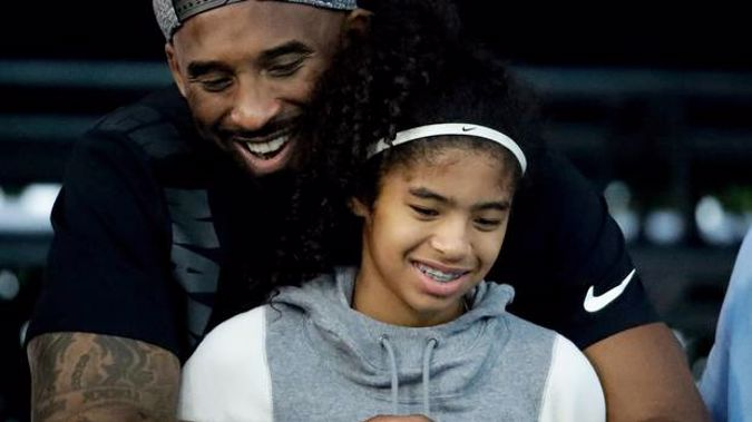 In this July 26, 2018, file photo former Los Angeles Laker Kobe Bryant and his daughter Gianna watch during the U.S. national championships swimming meet in Irvine. (Photo / AP)