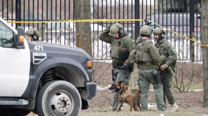 Police work outside the Molson Coors Brewing Co. campus in Milwaukee. Photo / AP