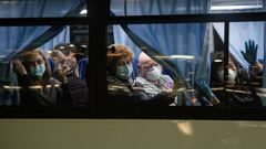 American citizens wave from a bus as they leave the quarantined Diamond Princess cruise ship at Daikoku Pier to be repatriated to the United States. Photo / Getty Images